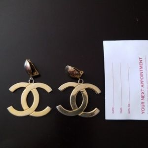 Logo clip on earrings in good condition